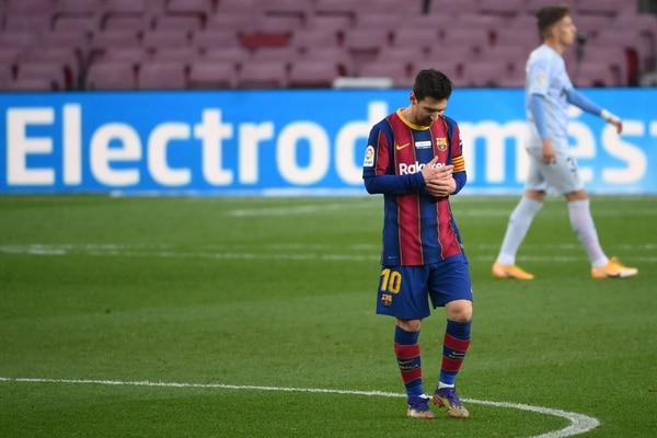 Barcelona's Argentinian forward Lionel Messi walks on the pitch during the Spanish league football match between FC Barcelona and Valencia CF at the Camp Nou stadium in Barcelona on December 19, 2020. (Photo by LLUIS GENE / AFP)
