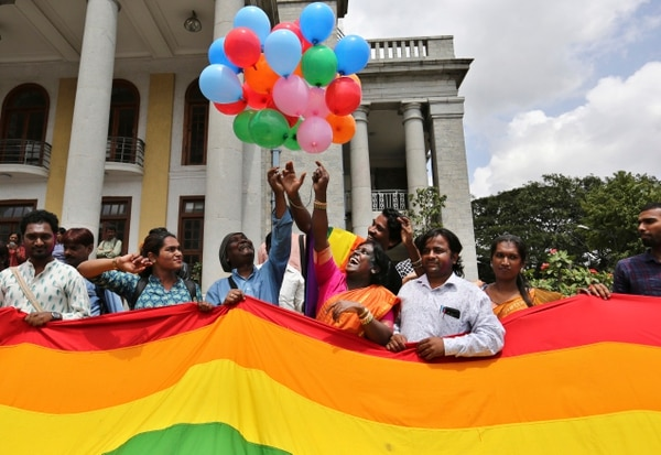 Transgender rights activist Akkai Padmashali, center in orange dress, celebrates with members of the LGBT community after the country's top court struck down a colonial-era law that made homosexual acts punishable by up to 10 years in prison, in Bangalore, India, Thursday, Sept. 6, 2018. The court gave its ruling Thursday on a petition filed by five people who challenged the law, saying they are living in fear of being harassed and prosecuted by police. (AP Photo/Aijaz Rahi)