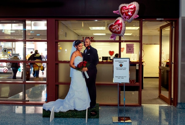 The Clark County Clerk's Office operates a temporary pop-up marriage license office at McCarran International Airport in Las Vegas on February 12, 2018. The Las Vegas airport has given new meaning to rushing to make a connection, offering quickie wedding licenses for lovebirds desperate to get hitched on Valentine's Day. Clark County, the authority that administers Sin City's weddings, has opened a pop-up marriage license bureau by a baggage carousel at McCarran International Airport. / AFP PHOTO / L.E. Baskow / TO GO WITH AFP STORY,