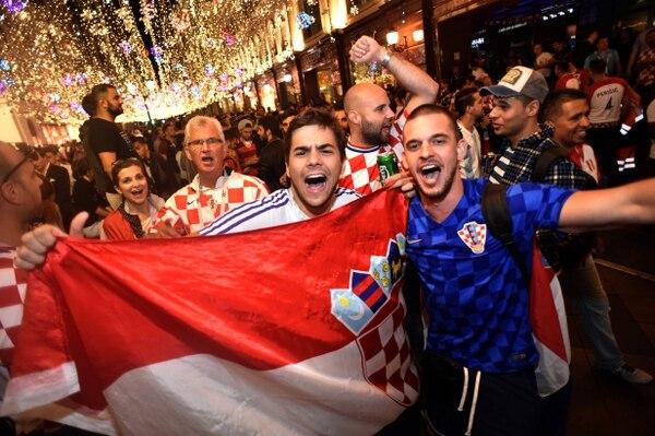 Los croatas que ahora disfrutan gracias al fútbol, guardan heridas de la guerra. Fotografía: AFP