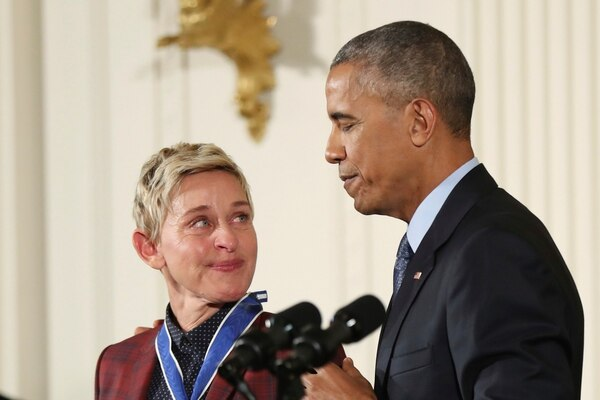 FILE - In this Nov. 22, 2016 file photo, actress, comedian, and talk show host Ellen DeGeneres, glances at President Barack Obama as she is presented the Presidential Medal of Freedom during a ceremony in the East Room of the White House in Washington. DeGeneres made history 20 years ago as the first prime-time lead on network TV to come out, capturing the hearts of supporters gay and straight amid a swirl of hate mail, death threats and, ultimately, dark times on and off the screen. (AP Photo/Manuel Balce Ceneta, File)