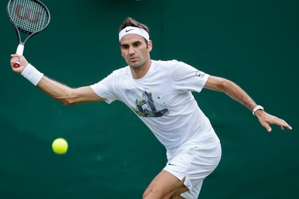 Roger Federer of Switzerland competes during a training session at the All England Lawn Tennis Championships in Wimbledon, London, Friday, June 30, 2017. (Peter Klaunzer/Keystone via AP)