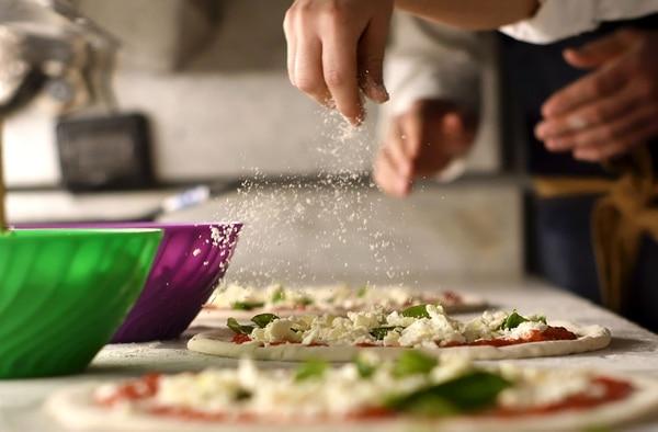 La pasión italiana en cada pizza se nota en el sabor y la calidad de los ingredientes. AFP.