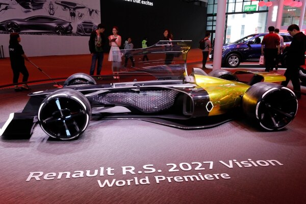 Visitors look at the Renault R.S. 2027 vision concept car at the Renault stand during the Auto Shanghai 2017 show at the National Exhibition and Convention Center in Shanghai, China, Thursday, April 20, 2017. Models on display at the Auto Shanghai 2017, the global industry's biggest marketing event of the year, reflect the conflict between Beijing's ambitions to promote environmentally friendly propulsion and Chinese consumers' love of hulking, fuel-hungry SUVs. (AP Photo/Ng Han Guan)