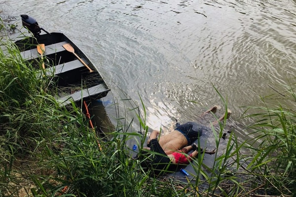 TOPSHOT - CORRECTION - View of the bodies of Salvadoran migrant Oscar Martinez Ramirez and his daughter, who drowned while trying to cross the Rio Grande -on their way to the US- in Matamoros, state of Tamaulipas on June 24, 2019. - Twenty-five-year-old Oscar Martinez Ramirez fled El Salvador with his 21-year-old wife and their daughter and decided to make the risky crossing from Mexico to the US on Sunday afternoon, according to a Mexican court report seen by AFP. Ramirez carried the little girl on his back, stowing her inside his t-shirt to keep her safe as they attempted to cross the river. But the pair were swept away by violent currents, drowning before her mother's eyes, who survived the ordeal and arrived on shore. (Photo by STR / AFP) / �The erroneous mention[s] appearing in the metadata of this photo by STR has been modified in AFP systems in the following manner: [state of Tamaulipas] instead of [state of Coahuila]. Please immediately remove the erroneous mention[s] from all your online services and delete it (them) from your servers. If you have been authorized by AFP to distribute it (them) to third parties, please ensure that the same actions are carried out by them. Failure to promptly comply with these instructions will entail liability on your part for any continued or post notification usage. Therefore we thank you very much for all your attention and prompt action. We are sorry for the inconvenience this notification may cause and remain at your disposal for any further information you may require.�