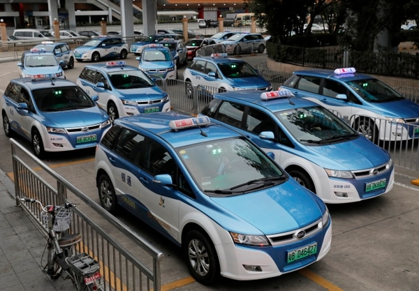 In this Monday, Jan. 7, 2019, photo, new electric-powered taxis are seen in Shenzhen city, south China's Guangdong province. One of China's major cities has reached an environmental milestone, an almost all electric-powered taxi fleet. The high-tech hub of Shenzhen in southern China announced at the start of this year that 99 percent of the 21,689 taxis operating in the city were electric. (AP Photo/Vincent Yu)