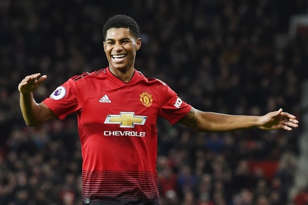 Manchester United's English striker Marcus Rashford celebrates after scoring during the English Premier League football match between Manchester United and Fulham at Old Trafford in Manchester, north west England, on December 8, 2018. (Photo by Paul ELLIS / AFP) / RESTRICTED TO EDITORIAL USE. No use with unauthorized audio, video, data, fixture lists, club/league logos or 'live' services. Online in-match use limited to 120 images. An additional 40 images may be used in extra time. No video emulation. Social media in-match use limited to 120 images. An additional 40 images may be used in extra time. No use in betting publications, games or single club/league/player publications. /