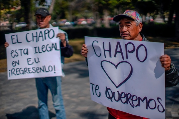 People show their support to Mexican drug kingpin Joaquin Guzman Loera, aka