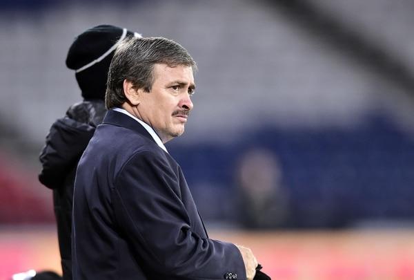 Por ejemplo, la foto de Óscar Ramírez, entrenador de la Tricolor, no aparece en el álbum porque es el técnico./ AFP PHOTO / NEIL HANNA